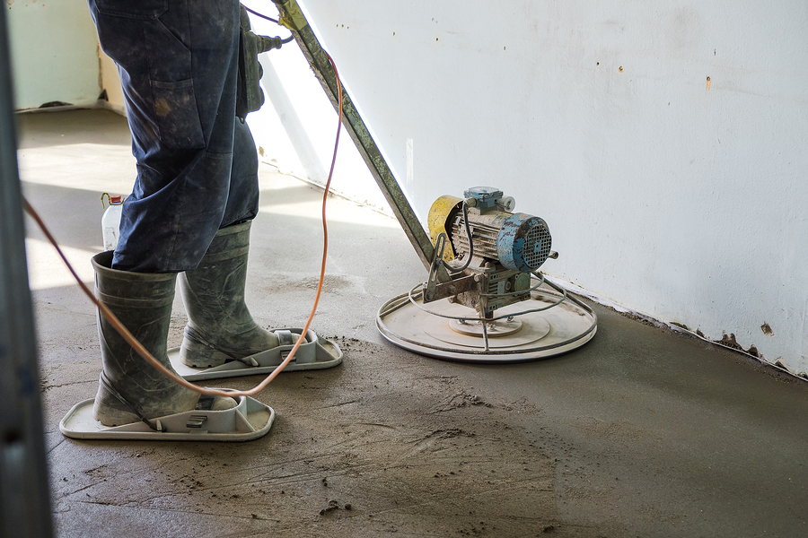 man making concrete house floor